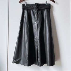 Black faux leather vegan A line belted midi skirt